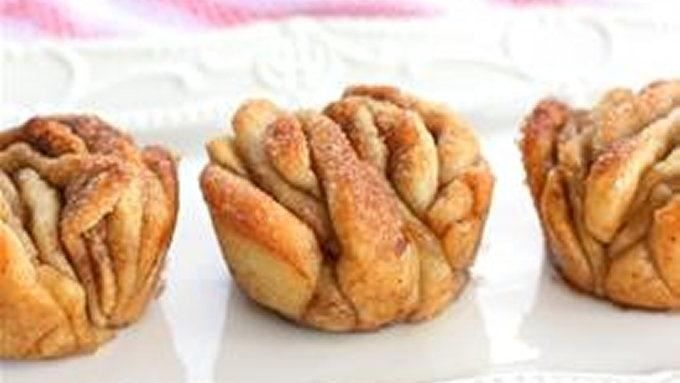 Like your favorite sweet pull-apart loaf, these individual muffins have layers of buttery cinnamon sugar to peel off and nibble to your heart's content.