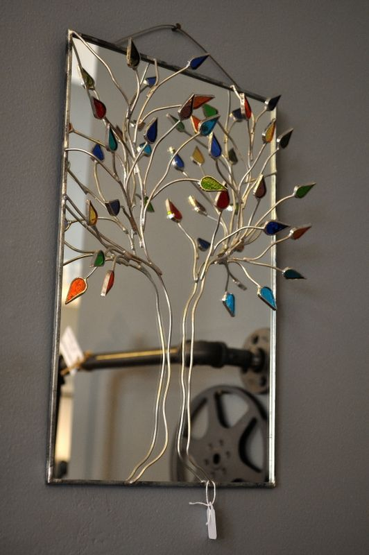 This unique, stained glass three-dimensional mirror would look perfect in a guest bathroom or entry hallway.