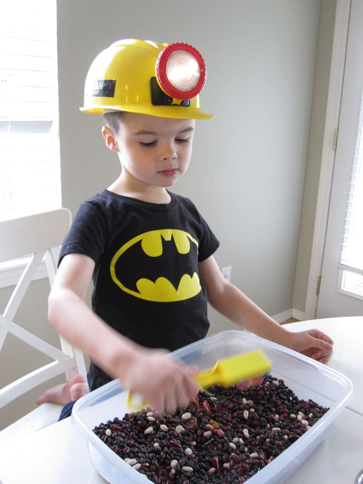 Mining for Magnets - Preschool Activity.  Also, this kid's batman shirt matched the colors so well that at first I thought it was a Batman sensory bin...