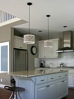 I love the white cabinets! I like this style kitchen.