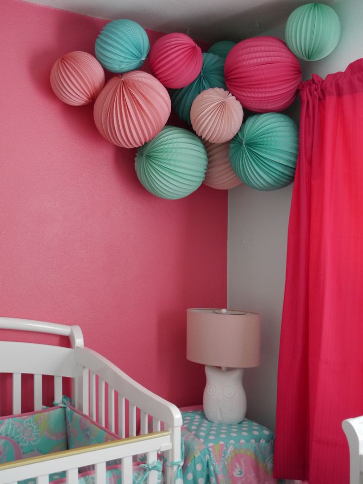 Martha Stewart pink and teal paper lanterns for a girl modern nursery from Livethefancylife.com