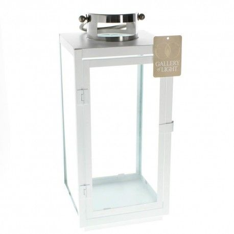 """Large Carrel White Iron Glass Candle Lantern LARGE CARREL WHITE LANTERN 10016385 This contemporary lantern will make a bold statement indoors or out. The iron framework features fresh white paint, four clear glass panels, and a hinged door so you can easily fill it with the candle of your choice. Its topped with a silvery finial and has a stylish hanging handle. Candle not included.  Dimensions     7.12"""" x 6.75"""" x 15.2"""" 19"""" high with handle."""