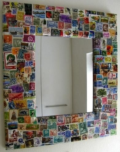 Decoupage mirror using postage stamps.