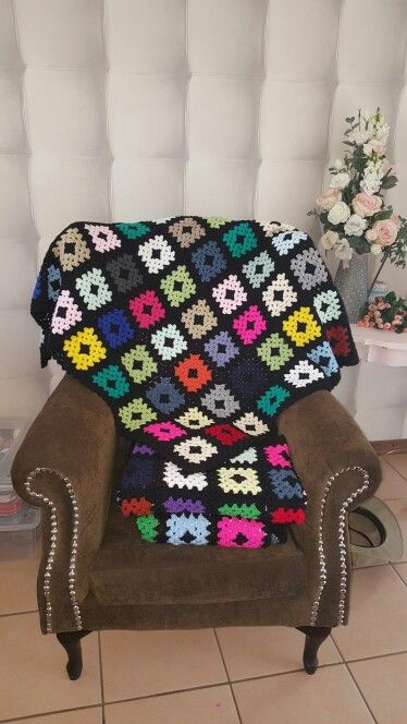 Crocheted multi coloured granny square  knee blankets made from scraps of wool left over from other projects.