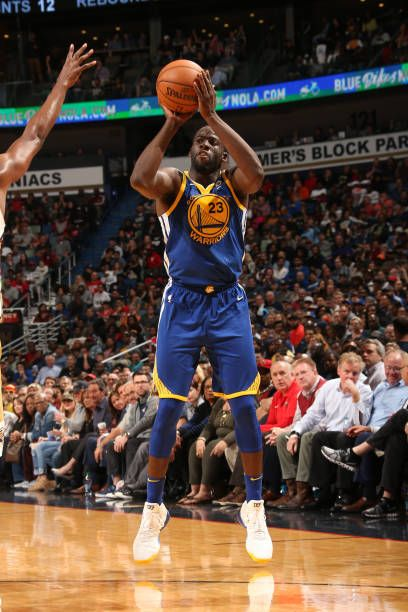 Draymond Green of the Golden State Warriors shoots the ball against the New Orleans Pelicans on December 4 2017 at Smoothie King Center in New...