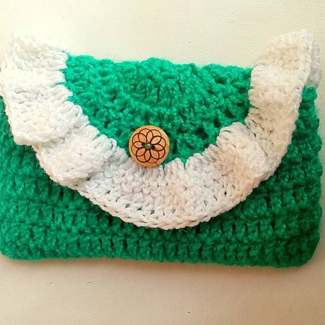 Crochet Clutch. Colors available.  For order and prices, kindly DM. #crochet #crochetting #crochetaddicts #crochetart #crochethook #crochetlife  #crochetlifestyle #crochetlover #crochetter #delhi #crochetterdelhi #love #instagood #beautiful #art #crochetporn
