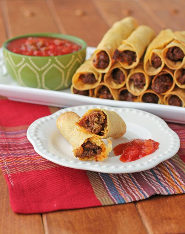 These baked Spicy Beef Taquitos are perfect football party food or great for Taco Tuesday! Only 98 calories or 2 Weight Watchers SmartPoints each! www.emilybites.com #healthy