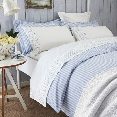 Coastal blue and white bedroom, layering bed linen