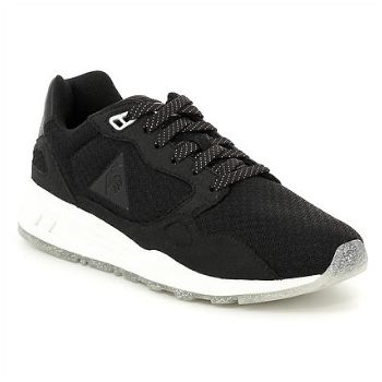 Le Coq Sportif LCS R900 W Sparkly Sneakers: The LCS R900, little sister to the iconic LCS R1000, is one of the stars of the season. Its upper has been redesigned, but it is right on-trend with the retro running shoe movement.The lightweight features Dynactif cushioning, making it comfortable under any circumstances, in white mesh accented with synthetic leather and suede onlays. Ultra feminine. Subtle details, like a gold glitter outer sole and a shimmery bonded logo, complete the look.