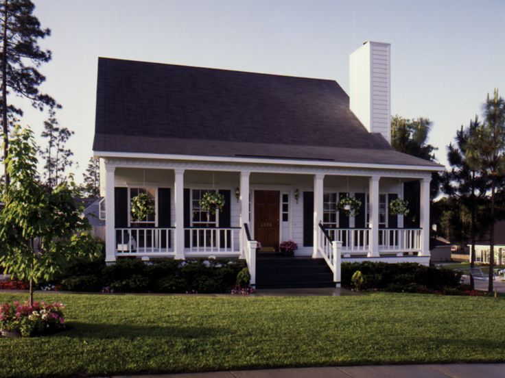 Classic Acadian Home With Beautiful Covered Front Porch