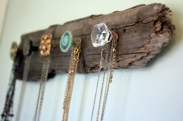 vintage drawer pulls on driftwood to display vintage jewelry