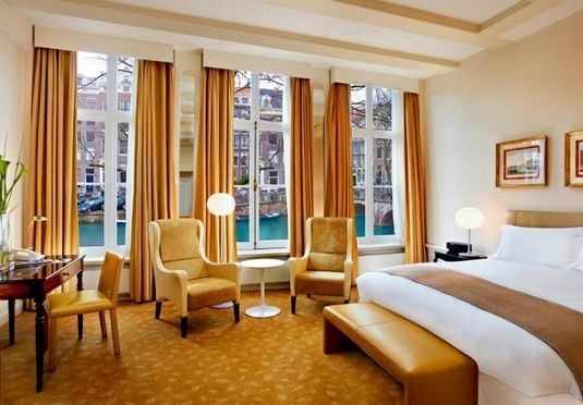 An elegant stay in a historic, five-star Amsterdam hotel, with breakfast and travel