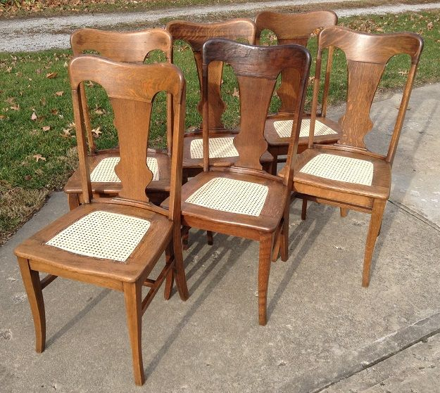Set of six quarter-sawn oak side chairs with sheet cane seats. Remarkable tiger-stripe grain. For sale $330.