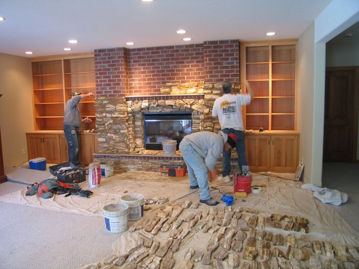 Re-cover a brick fireplace with stone.  If we ever have a house with an ugly brick fireplace again...