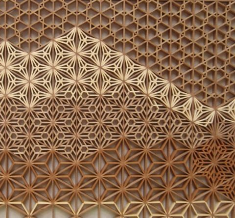 Wood lattice.  Could also cut paper designs
