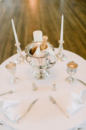 table at Chez Monique in Pursued by the Player (classic silver reception table settings | Pasha Belman)