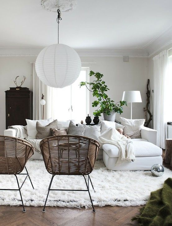 living room setup, white sofa with bright colored Korean accent pillows and Bruno Mathsson chairs across from them with some fur throw 199 DKK/stk for sheepskin and 89 DKK/stk for faux sheepskin