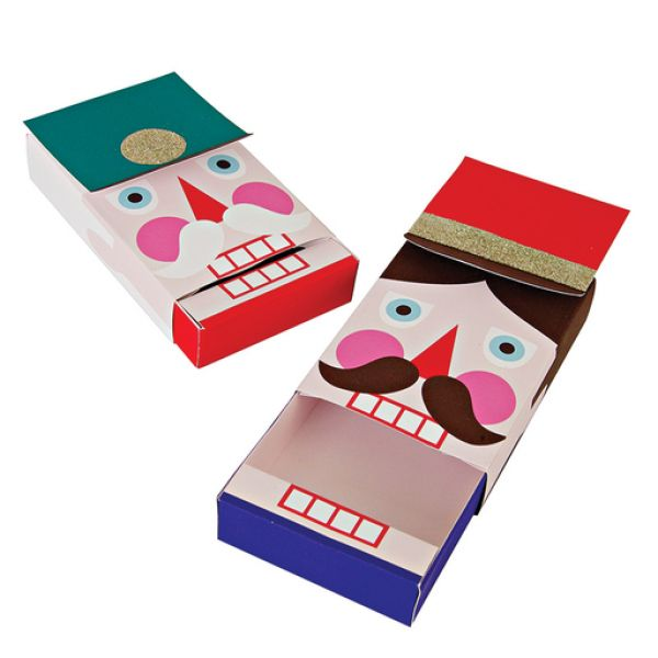Meri Meri Nutcracker Mechanical Gift Box Set: These delightful gift card boxes are cleverly crafted in the shape of individual Nutcracker characters, each with its own color scheme and embellishments. Each box is finished with gold glitter.Pack contains 4 gift boxes.