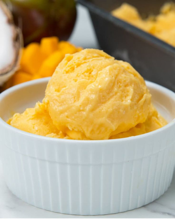 Here's what you'll need:* 3 cups frozen mango, diced* ½ cup coconut milk* ½ cup Greek yogurt* 2 tablespoon honeyHere's what you'll do:1.Combine ingredients into a food processor or high-speed blender.2.Pour into a pan and smooth into an even layer.3.Freeze for 2 hours, or until frozen but still a little soft for scooping. (If freezing overnight, cover with a lid or plastic wrap, but let it sit out at room temperature for about 5-10 minutes before scooping).4.Scoop into a bowl and top with…