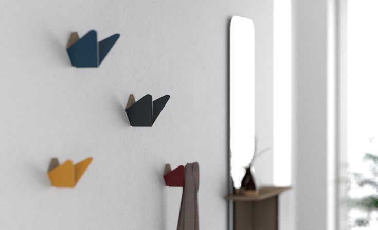 Butterflies is a multipurpose dual coat hook that keeps your small items just where you need them. Its stylish and minimal form makes an eye-catching design statement in the home, office or other interior setting.