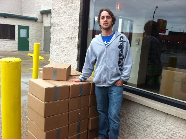 Bookwallah volunteer Thomas helping to get books sorted, entered into our database and ready for shipment to India.
