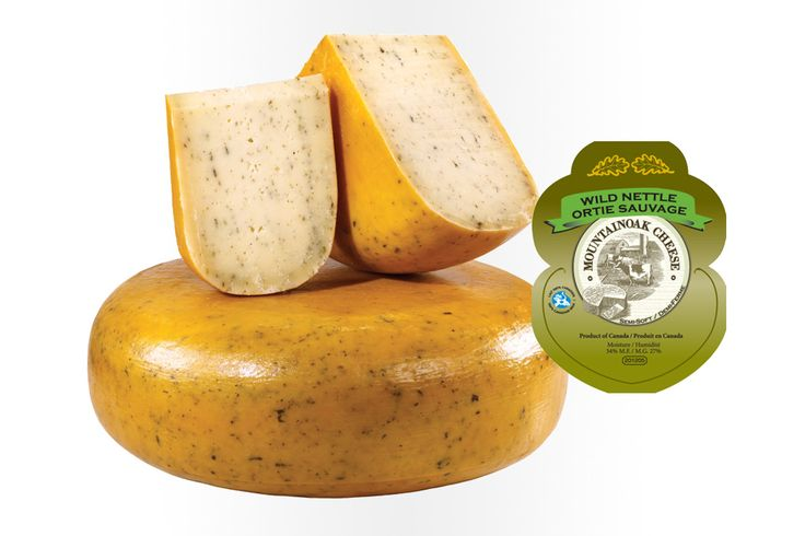 """Mountain Oak """"Wild Nettle"""" Gouda Cheese: One of Mountain Oak Cheese company's most popular varieties, the Wild Nettle provides an herbal, earthy flavour. When combined with the creamy farmstead gouda, these combinations create an exceptional taste experience. Ingredients: Whole milk, wild nettle, bacterial culture, calcium chloride, rennet."""