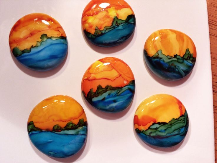 """Painted 1"""" white glass marble gems with alcohol ink."""