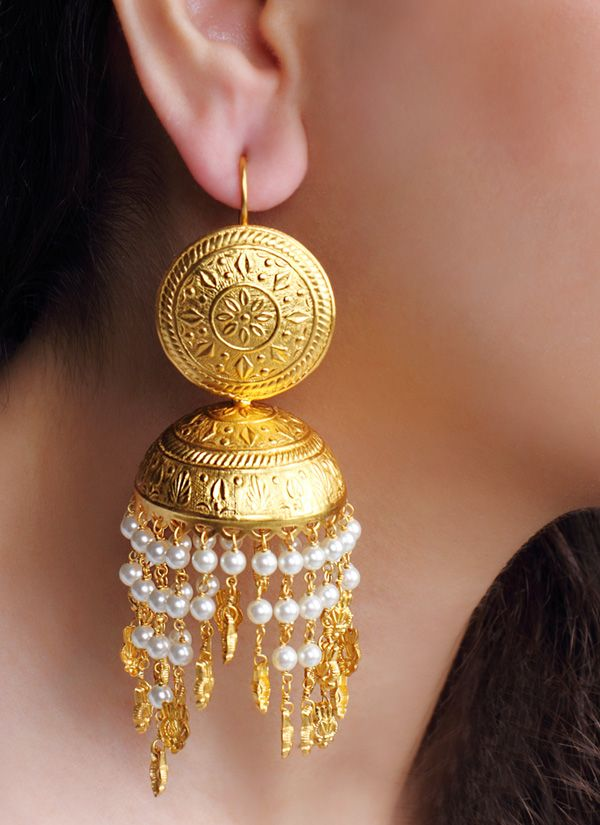 This pair of gorgeous earrings by Urban Dhani is made to add dazzle to your look. The golden jhumkas have an engraved metal top, attached to a hoop. Engraving on the jhumkas enhances the charm of the earrings. What's more, they even have rows of pearls with gold hangings that make the earrings a must have in your ethnic jewellery collection.