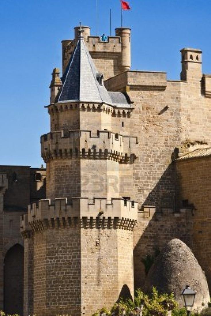 """CASTLES OF SPAIN - Palacio Real de Olite, construido durantes los siglos XIII y XIV. Fue una de las sedes de la Corte del Reino de Navarra a partir del reinado de Carlos III """"el Noble"""". El conjunto formado por estancias, jardines y fosos, rodeados por las altas murallas y rematados por las numerosas torres, le confieren una espectacular y mágica silueta. En su época, llegó a ser considerado uno de los palacios más bellos de Europa."""