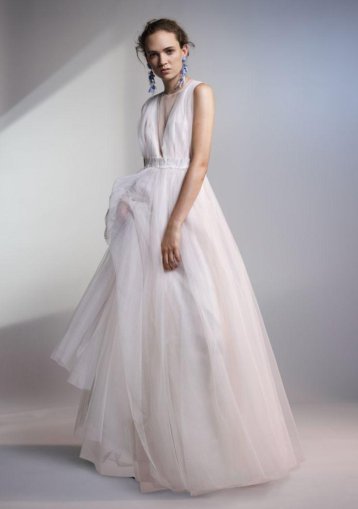 Brautkleid ausweißem Tüll, um 250 Euro