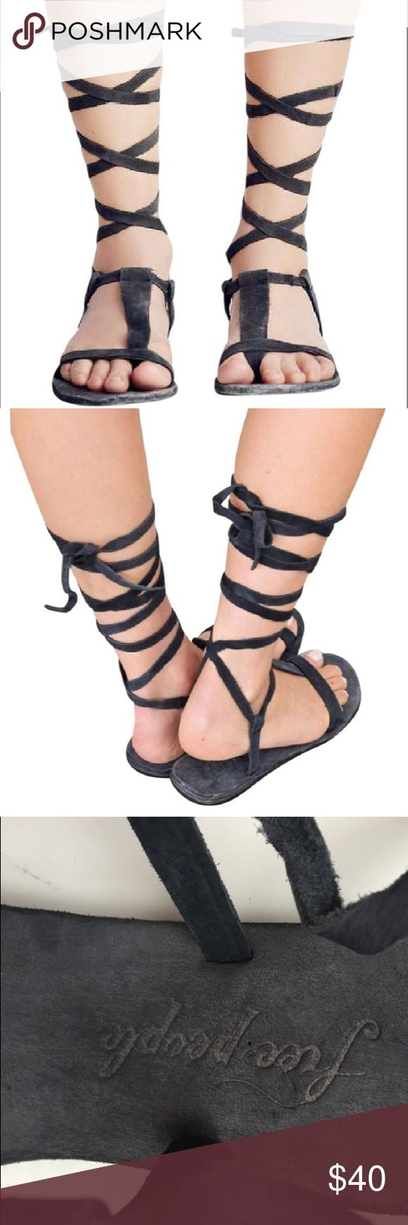 Free People Dahlia Lace Up Sandal Washed Black 5 These beautiful sandals scream BoHo! They would be perfect for festivals or your beach vacation or anytime you just want to add some flair to your outfit.  They are washed black in color, which almost has a navy or blue cast to the color.  They are rustic and really cute!  Women's size 5. Free People Shoes Sandals