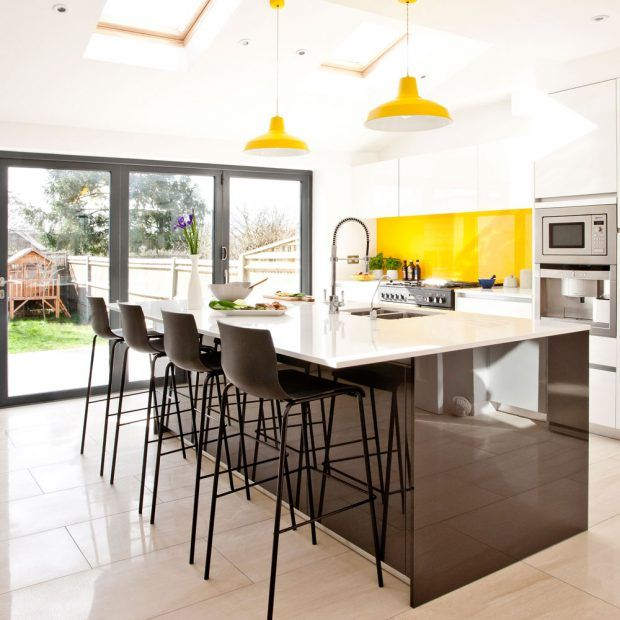 White and black gloss kitchen island bright yellow accents