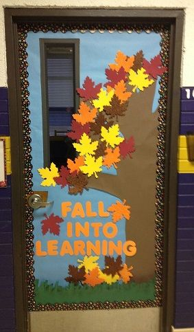 """Fall Into Learning"" - Colorful autumn classroom door display. Have student write their names and learning goals on the leaves."