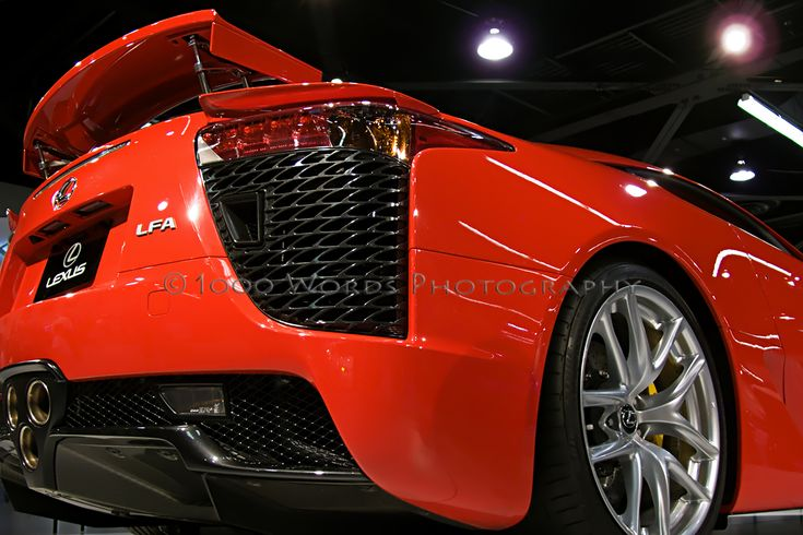 • #1000WordsPhotography • The 1st time the OC Auto Show threw open its doors, the Beatles dominated radio, hamburgers cost 19 cents & the Ford Mustang had just come on the market.  This is the $350,000 Lexus LFA.   The chassis & body are made largely of carbon-fiber composite, just like those of an Enzo or a Mercedes SLR McLaren.  The car weighs 3263 pounds - less than a Corvette ZR1.  The engine makes 553 horsepower, with the help of a 4.8-liter V-10, co-developed with Yamaha.