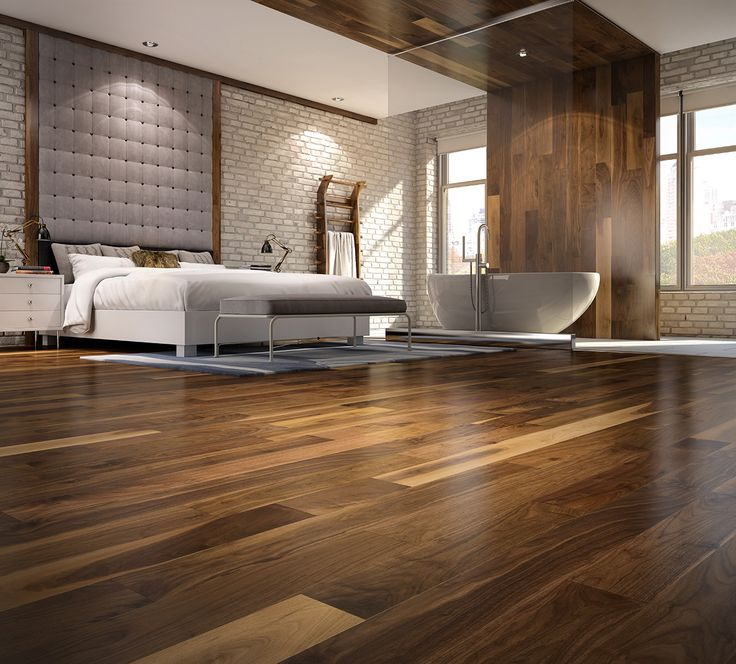 Chambre à coucher luxueuse avec bain et plancher de bois franc. Luxurious modern bedroom with hardwood floor and bath in the room,