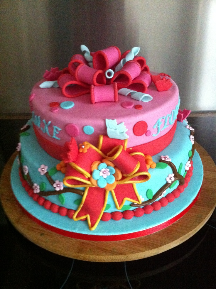 Colourful birthday cake with bow
