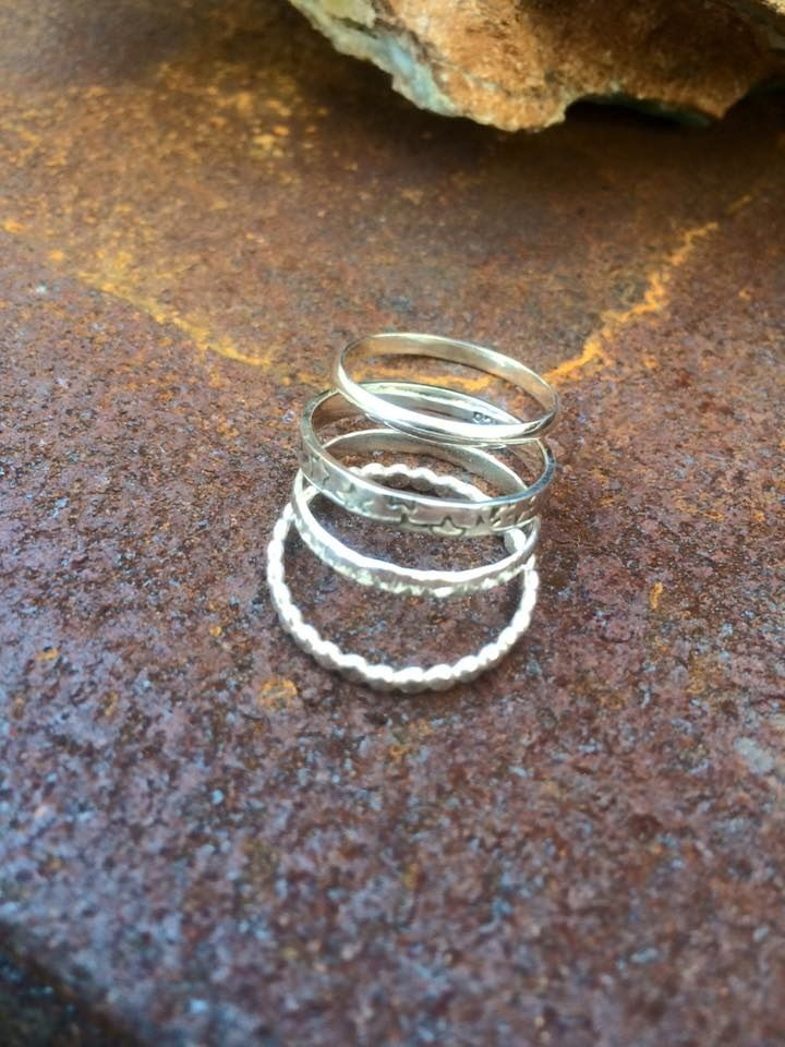 """This stacking ring set includes the """"energy of life"""" stacking set and a starlight stacker, 4 rings in total  - plain  - pearl hammered - textured band  - starlight stacker made from 925 recycled silver"""