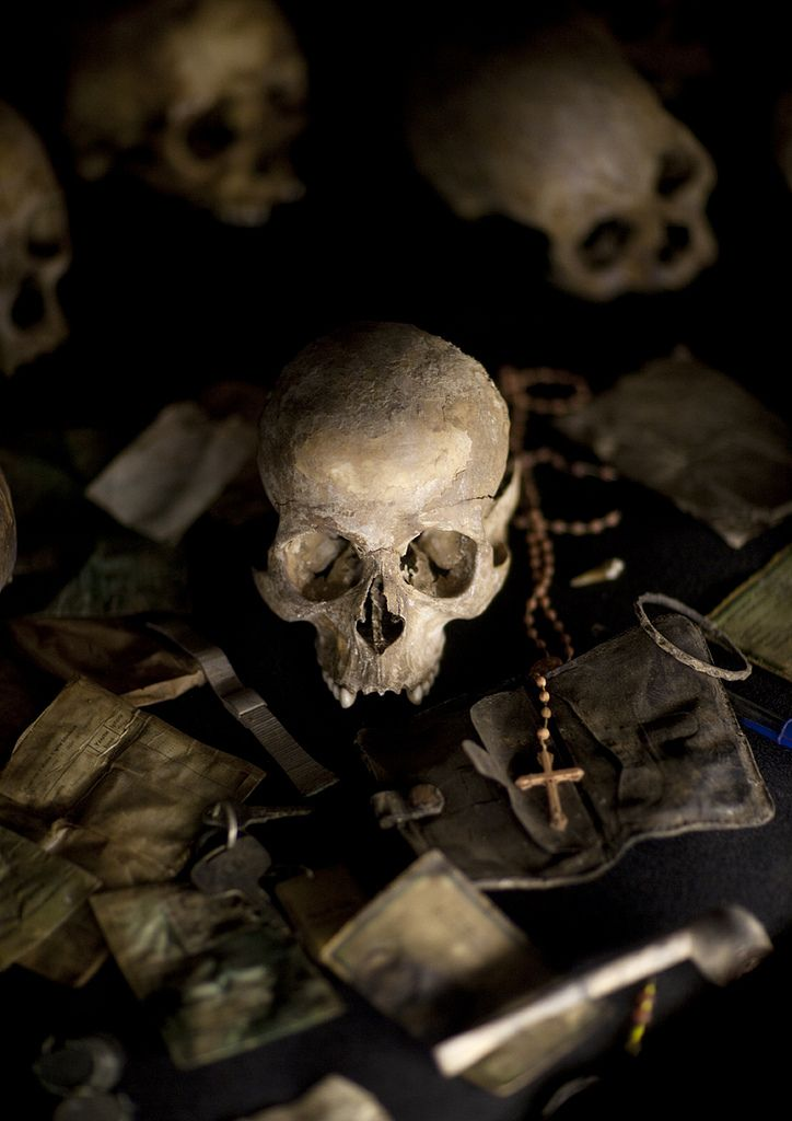 """Human skull at Kigali Memorial Centre, Rwanda   •   """"During 100 days, from the assassination of Juvénal Habyarimana on April 6 1994 through July, at least 800,000 people were killed, according to a Human Rights Watch estimate...""""    © Eric Lafforgue"""