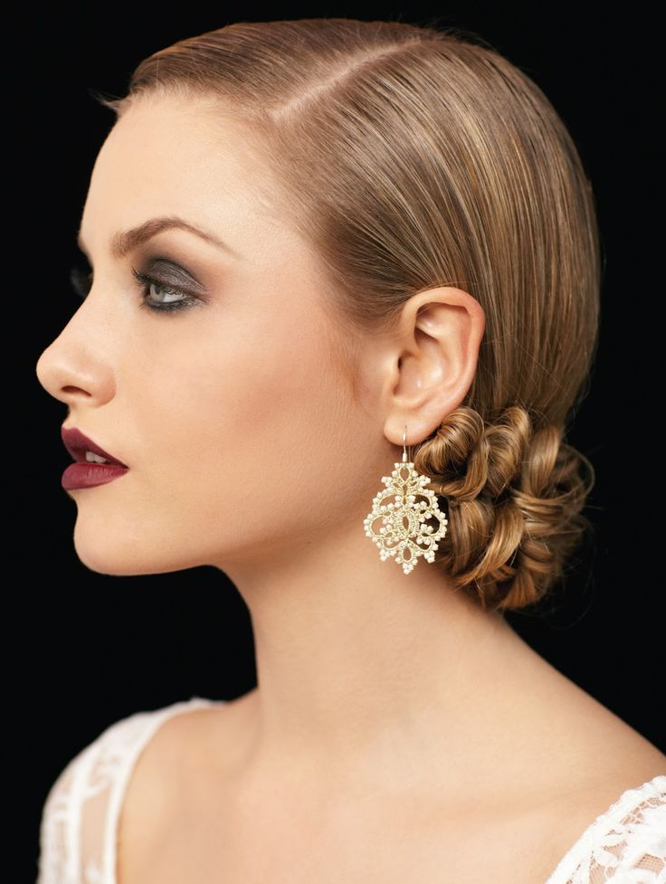 Sleek side part, hair pinned low at name of neck. Very Old Hollywood glam