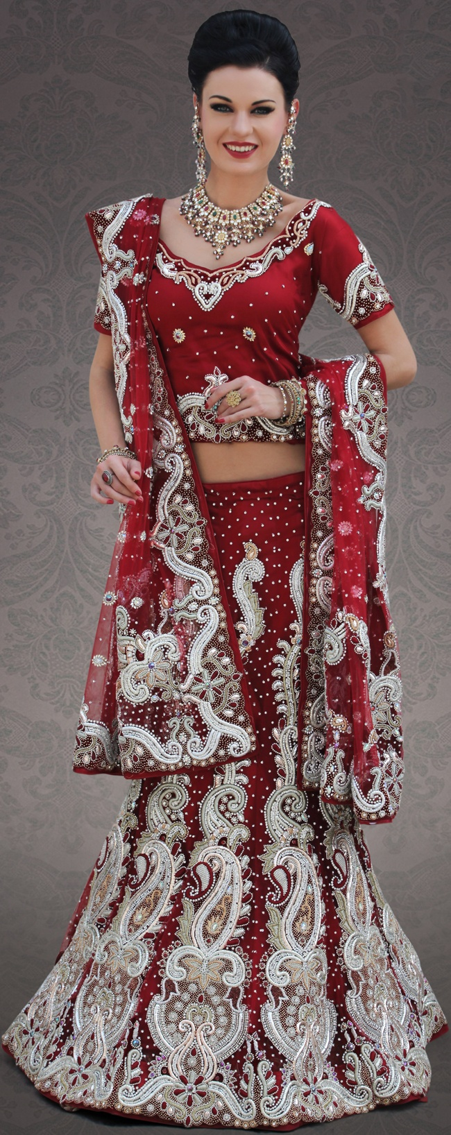 Let your personality speak for you this wedding lehenga embellished with embroidery work. This maroon net lehenga choli is nicely embroidery and velvet patch work is done with stone, zardosi, cutdana, beads and cutbeads work. All over embroidery work on lehenga is stunning. The beautiful heavy embroidery on lehenga made it awesome and gives you stylish and attractive look to others. Matching choli and dupatta is availble with this lehenga.