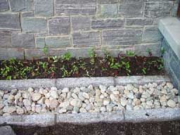 An example of a French drain. Looking at doing this around the house next year instead of gutters :)
