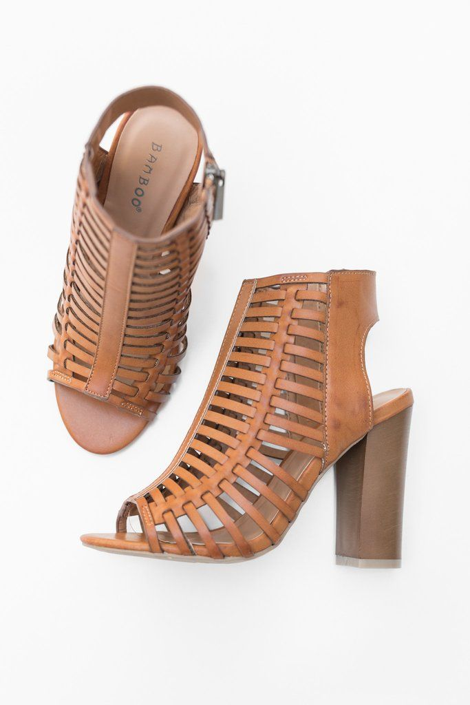 Tan faux leather strappy sandals with an open toe, side zipper and 4 inch  heel