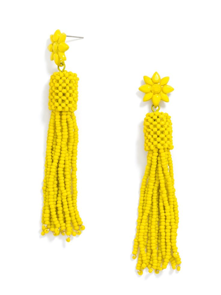 Monochromatic statement earrings are both elegant and edgy - think Rihanna at the Met Ball.