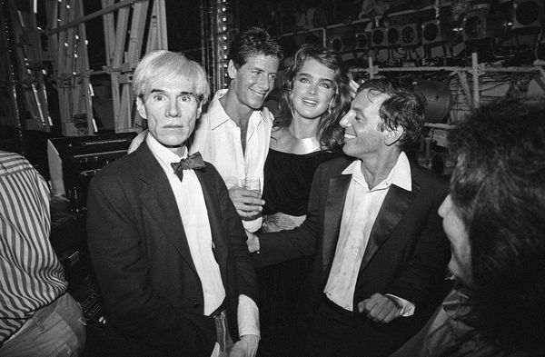 Studio 54 re-opens under new management and after renovations.///Andy Warhol, Calvin Klein, and Brooke Shields join Steve Rubell in the DJ booth.