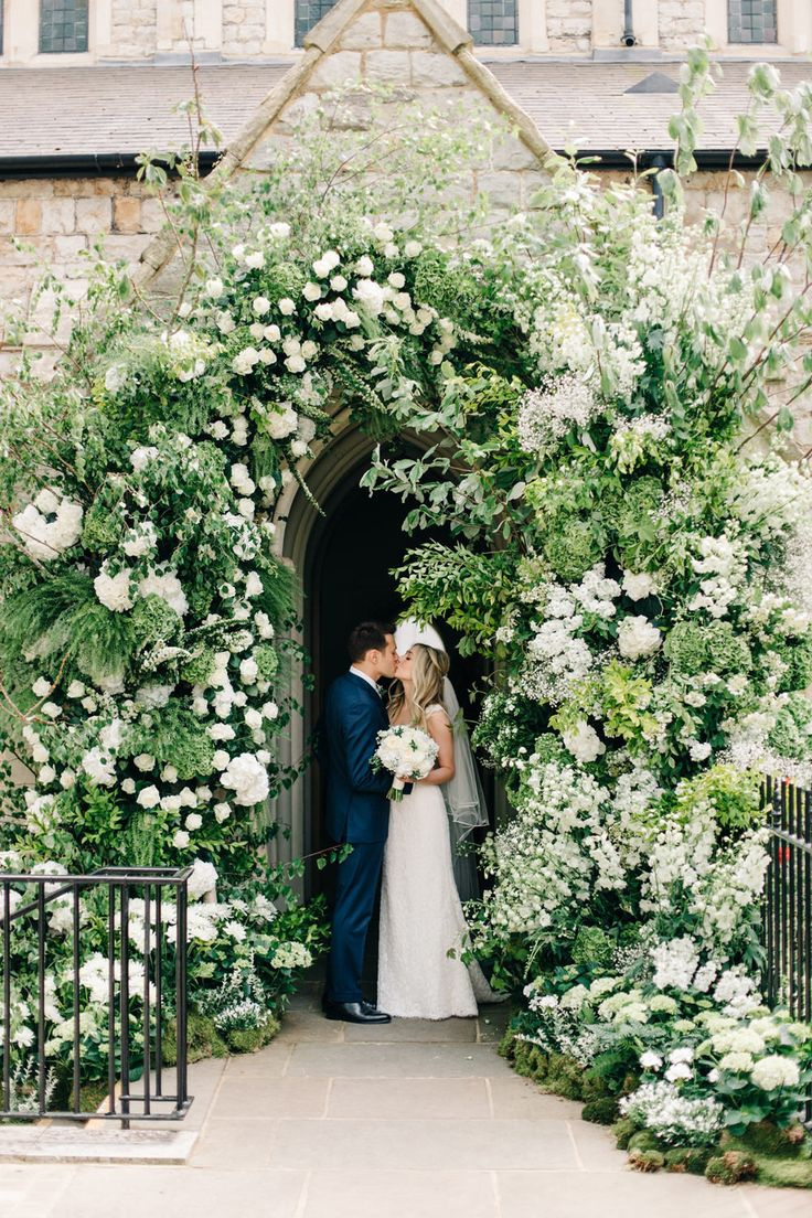 Bride & Groom Flower Arch Portrait - M&J Photography | Elegant London Wedding | White & Greenery Florals