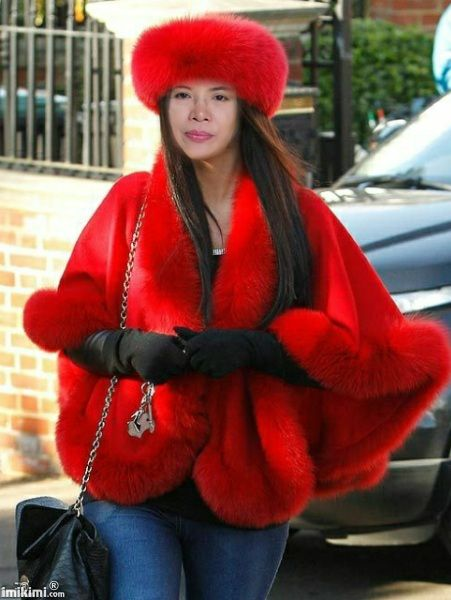Very trendy red poncho and hat