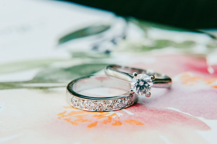 Diamonds are a girl's best friend next to her new hubby | Bride wedding band and engagement ring | Elegant white and pink ballroom wedding | Photography: Bassem
