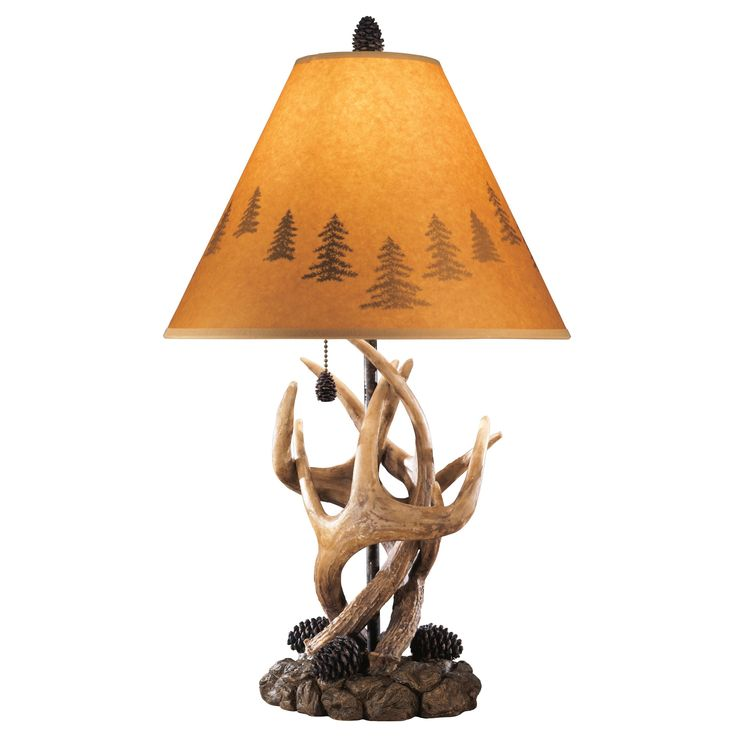 This rustic lamp set features fun antlers and pine cones as the base with an orange silhouette shade. Illuminate your room in a vintage style today.