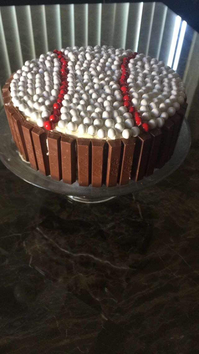 Baseball cake I made for my boyfriend. I stacked two circle cakes together with icing and then put sixlets on top and bordered it with kit kats cause those are his favorite.