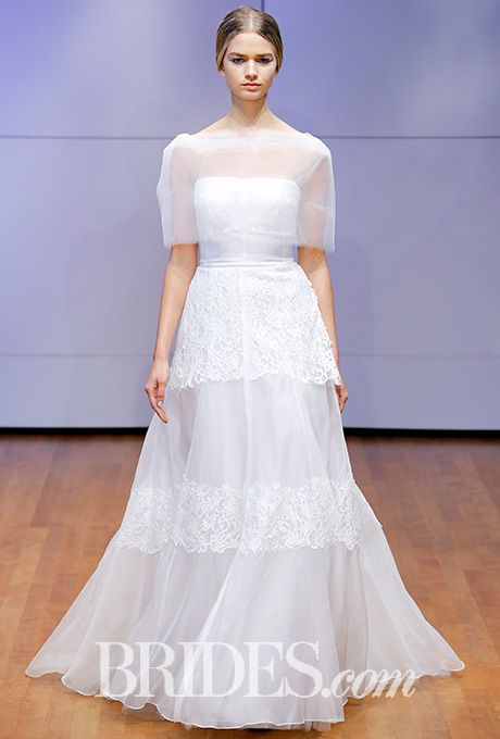 Brides.com: . Deconstructed wedding dress with alternating translucent and chantilly lace panels, Rivini by Rita Vinieris